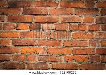 Red Background and Texture Of Facade Walls Of Old Brick. Vignette.