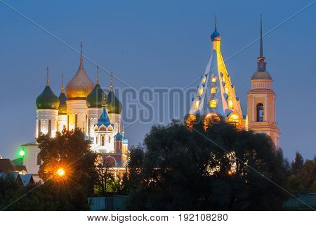 Kolomna Moscow Region. Temples And Belltower On Assumption Cathedral Square In Bright Illumination Under Blue Sky Evening Close Up.