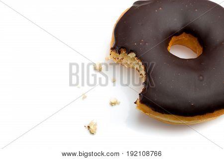 Chocolate doughnut dough glaze bitten white background