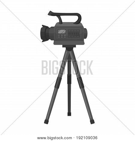 Movie camera on a tripod. Making a movie single icon in monochrome style vector symbol stock illustration .