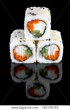 Sushi with squid caviar of masago and cucumber on a black background with reflection