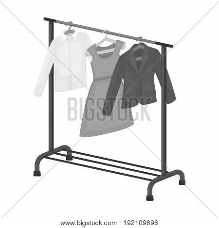A hanger with things in the wardrobe.Making movie single icon in monochrome style vector symbol stock illustration .