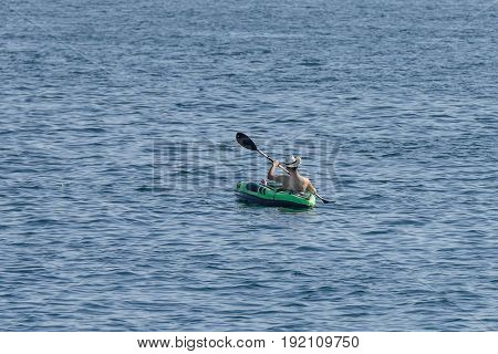 image if young man canoeing in the sea