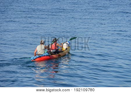 image if man with woman canoeing in the sea