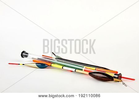 Fishing colorful floats. Angler tackle on white background.