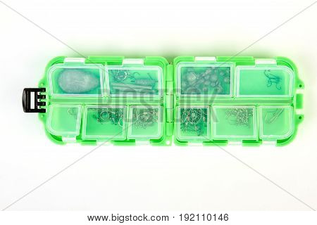 Plastic fishing box on white background. Tackle box with binding element isolated.