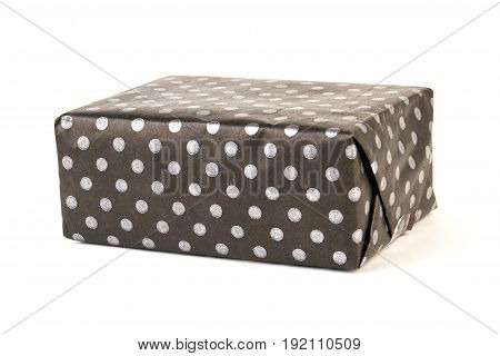 Box wrapped in black paper. Dark box on white background.