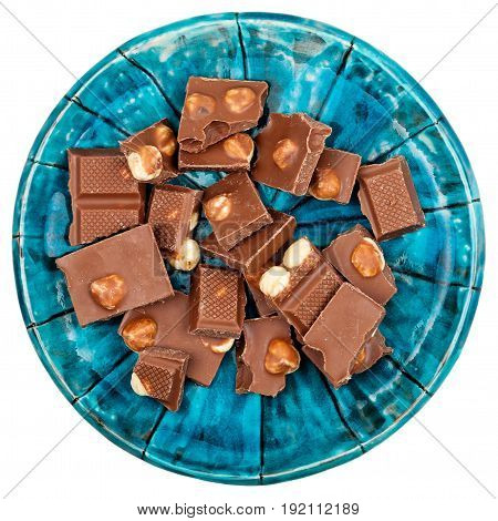 Milk chocolate with nuts in a plate isolated on white