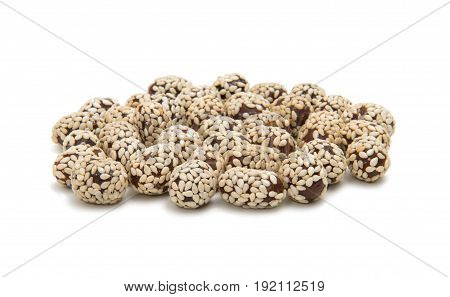 Peanuts in sesame seeds on white background