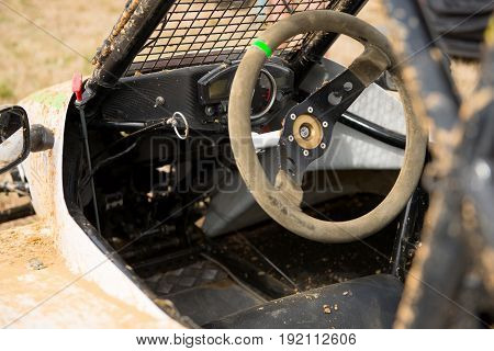 a steering wheel of a kartcross buggy