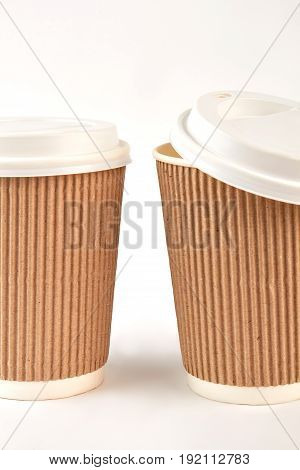 Closeup ripple paper cups. Disposable portable coffee mugs.