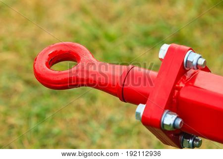Industrial details mechanical objects and tools concept. Tow hitch on steel big machinery closeup