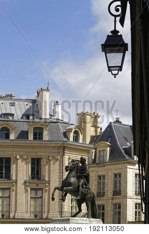 Paris, France, June 16, 2017 : At The Center Of The Place Des Victoires Is An Equestrian Monument In