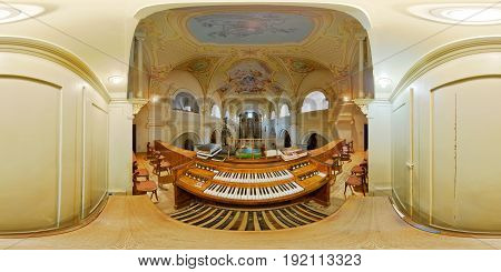 TARGU MURES, ROMANIA - April 17: 360 interior panorama from the organist's point of view of Saint John the Baptist Catholic Church in Târgu Mureș, Romania