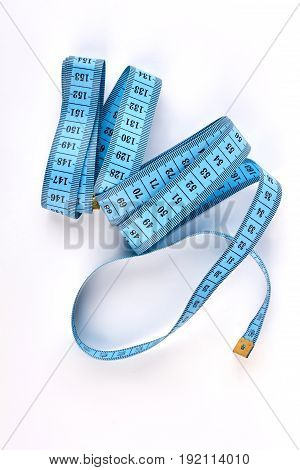 Blue measuring tape isolated. Measurement instrument for tailor.