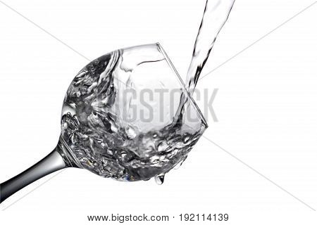 Water Pours Into A Glass On A White Background, Monochrome Image