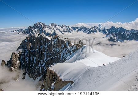 View from the intermediate landing (Plan de L'Aiguille), on the ascent of cable cars to the Aiguille du Midi, in French Alps Chamonix Mont Blanc, alpine mountains landscape, cloudy weather