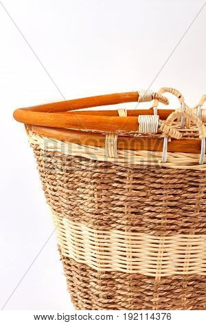 Vertical image of cropped basket. Brown wooden basket, white background.
