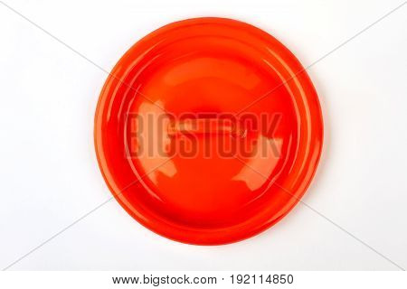Kitchen enameled lid isolated. Red dishware element, white background.
