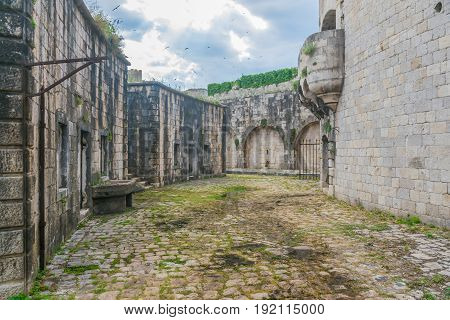 The Courtyard Is In The Military Fortress Of Mamula. Montenegro, Boka-kotor Bay.