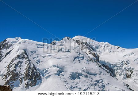 View of the Mont Blanc from the Aiguille du Midi, in French Alps Chamonix Mont Blanc, alpine mountains landscape, clear blue sky in warm sunny summer day