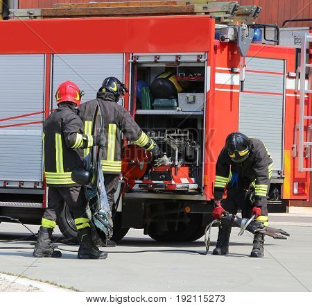 Fire Trucks And Firefighters With Uniforms And Protective Helmet