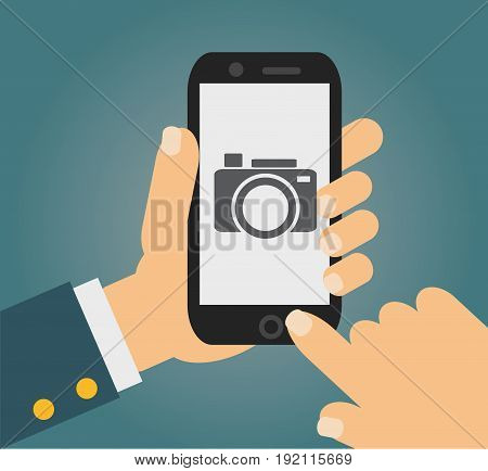 mobile phone with touchscreen - man taking photograph with digital device