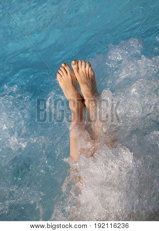 Woman Into The Spa Pool During A Therapeutic Hydromassage Sessio