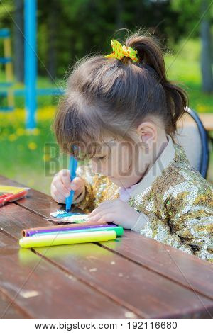Portrait of a girl drawing colored markers