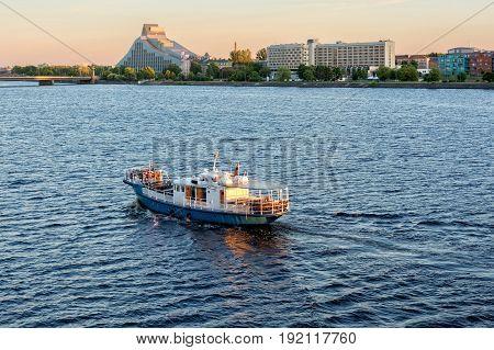 Riga, LV - JUNE 21, 2017: Floating ship in the Daugava river