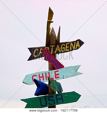 Sign directions pointing to various cities and countries