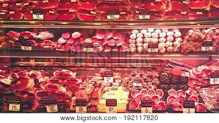 various cuts of fresh beef at the market
