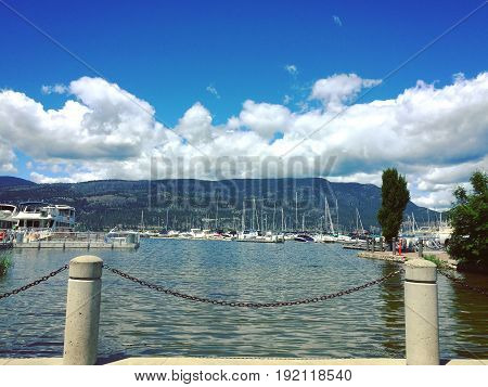 Downtown Kelowna waterfront with boats docked on Okanagan Lake summer 2017.