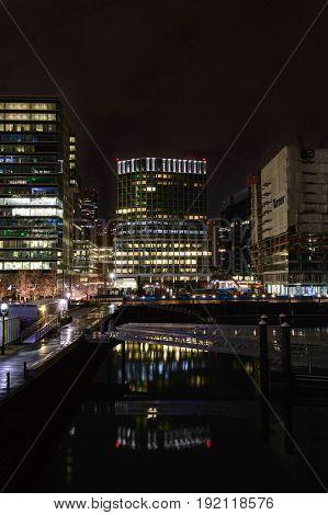 Boston Massachusetts USA - January 26 2017: Lights along Harborwalk reflecting off water on Boston waterfront