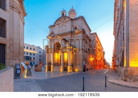 The Roman Catholic Church of St Catherine of Alexandria or St Catherine of Italy during morning blue hour, Valletta, Malta