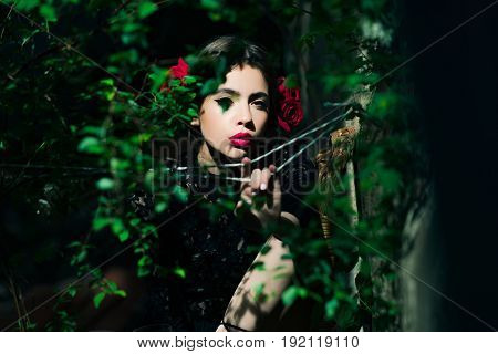 Woman With Red Lips And Roses In Hair