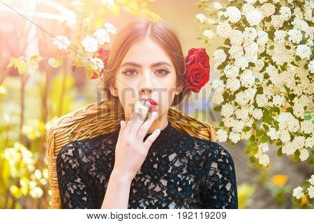 Pretty Girl With Stylish Makeup Holding White Flower In Mouth