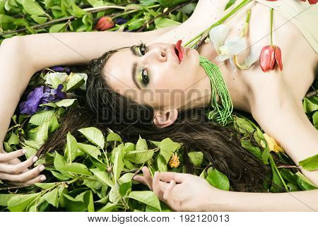 Beauty, Woman With Makeup With Flowers On Green Leaves