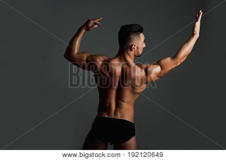 Muscular Man With Muscle Torso Showing Biceps And Triceps