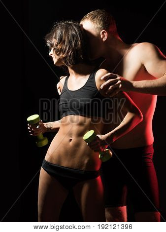 Sexy Woman And Athletic Man With Dumbbell
