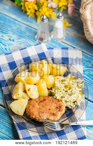Fried Pork Chop With Boiled Potatoes And Salad.