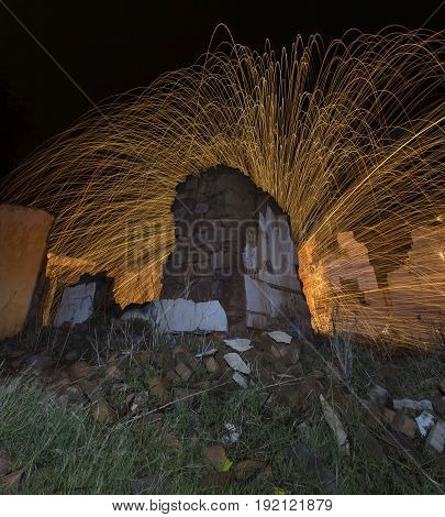 Light painting in an abandon house with spinning steel wool making fire