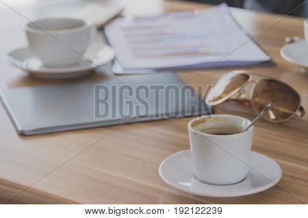 Coffee is placed on a table with business meetings.