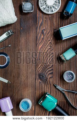 manicurist work place with manicure set and nail polish for hands care on wooden background top view mock up