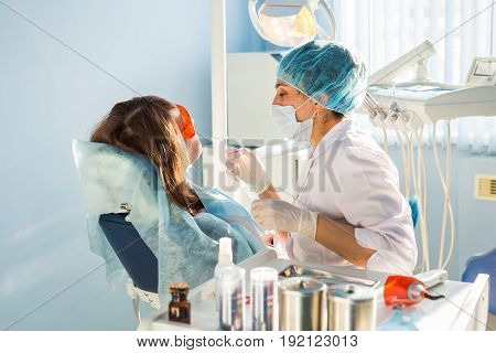 Teeth whitening procedure in the dental office close-up