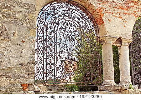 Old forged gate to armenian church Kamianets-Podilskyi, Ukraine