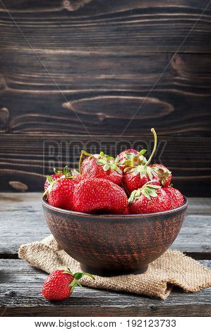 Fresh Strawberry In A Bowl On A Wooden Background