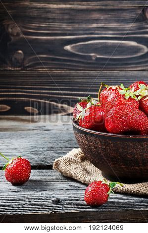 Bowl Filled With Succulent Juicy Fresh Ripe Red Strawberries On An Old Wooden Table