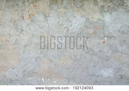 The texture of the old coarse cement plaster