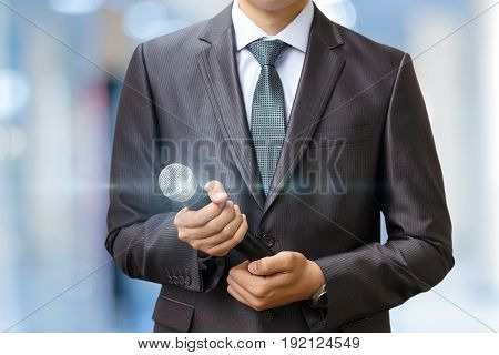 Businessman With A Microphone .